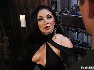 Dark haired ;dominatrix gives face sitting