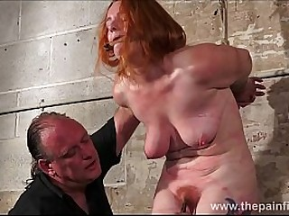 Slavegirl Fiona in former boyfriend dungeon bondage and hard breast punishments in the dungeon