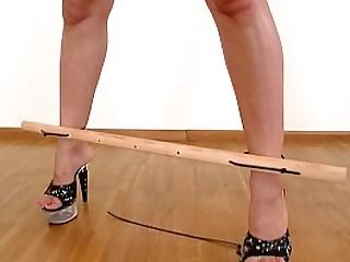Busty blonde Aleska Diamond masturbates Master's cock while crucified in BDSM fetish play