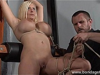 German rope whore Melanie Moons hogtied bondage and restrained busty submissive