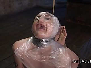 Brunette slave in extreme string bondage gets ass and pussy nailed