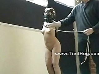 Sex gimp roped in leather bdsm