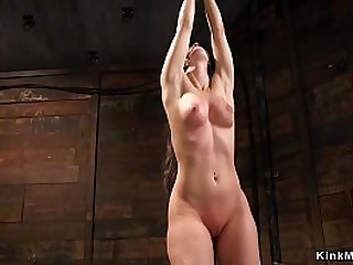Master ties up and whips sexy naked brunette slave