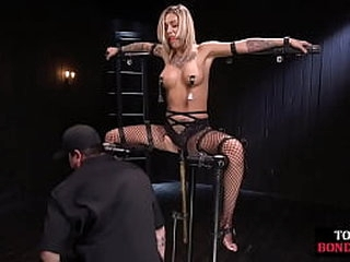 BDSM slave trussed and played while crooked