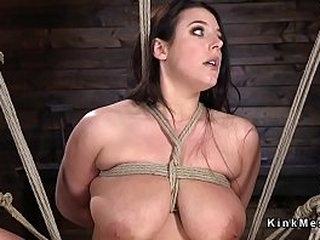 Busty brunette slave in wire bondage suspension gets her pussy fingered