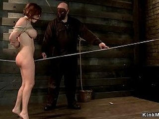 Big tits brunette slave walking and rubbing pussy on rope then in hogtie gets pussy fucked with dick on a stick by master