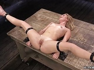 Petite blonde slave bent over in metal device restrain bondage gets spanked then stimulated and made squirting