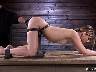 Gagged brunette in device restrain bondage whipped by master