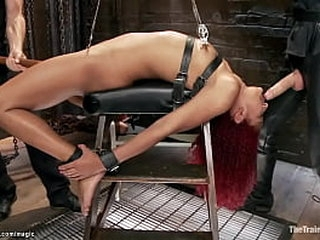 Curly redhead ebony Daisy Ducati in rope restrain bondage with pussy and thighs zippered gets whipped by master James Mogul then gangbang fucked