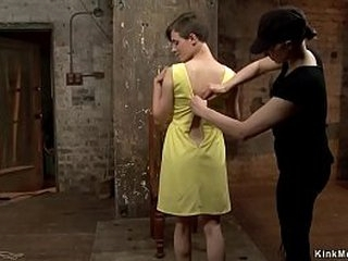 Brunette cutie in yellow dress strips then gets back arch bondage till in upside down suspension is hung for one leg by mistress Mz Berlin