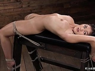 Dark haired beauty in rope restrain bondage fingered and in upside down whipped