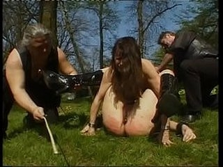 Two jaw-dropping girls tied up to a pole and whipped