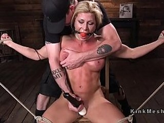Hogtied busty blonde whipped and spanked