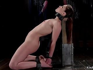 Sub in plastic corset in device bondage