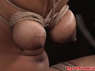 Busty black sub dildo fucked during bondage