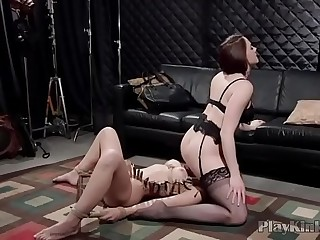 Mistress sitting on her slave nymphs face