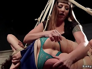 Suspended lesbian spanked before anal