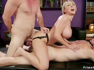 Milf bangs hubby while taking dick