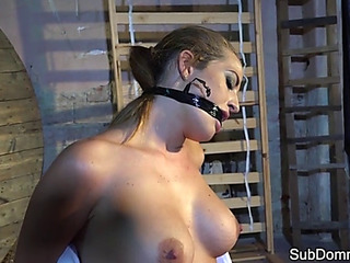 Gagged playgirl orgasms during slavery