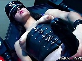 domination in shiny corsette and uniform