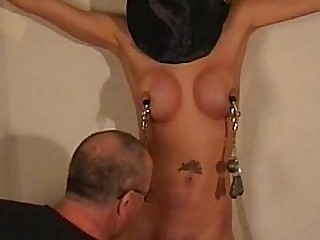 Busty restrain bondage honey Danii Black tit tortured and lashed in the dungeon with hard