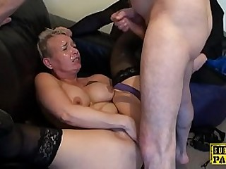 Mature Britt cocksucks dom in front of sissy