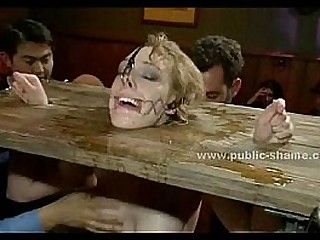 Blonde sex slave brought in public pub in extreme restrain bondage sex