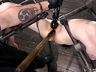 Brunette slut suffers different extreme bondage positions