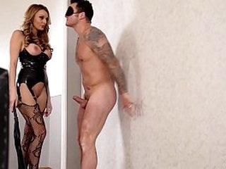 Latex domina Stacey Saran spanks & smallish submissive guy's big hard veiny cock