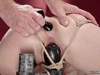 Ball-gagged and tied up in eagle spread restrain bondage blonde gets whipped then in strict rope restrain bondage