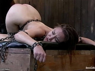 Chained brunette slave Gabriella Paltrova with ass sticked up gets butt flogged then in metal device bent over in strappado anal fucked with dildo on a stick by master