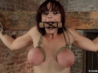 Lesbian mistress Claire Adams canes redhead big tits lesbian slave Bella Rossi and puts her in strapaddo then hangs her for tits on hogtie lezdom