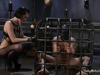 Submissive slave handled by his mistress