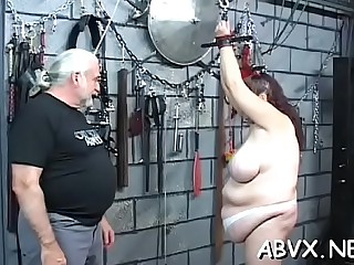 Gorgeous woman in heels strips and fucks herself