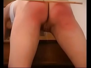 Schoolgirl'_s pussy is dripping while being caned