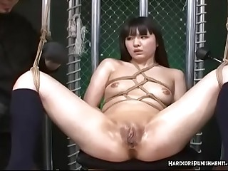 Ropes Binding Her Breasts This Asian Submissive Is Tantalized By Multiple Vibrating Wands